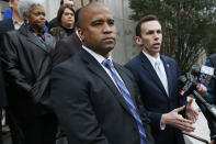 Republican State Auditor Shad White, right, and Hinds County District Attorney Jody Owens discuss the auditor's office investigation of the former director of Mississippi's welfare agency and four other people, accused of embezzling millions in federal money meant for the poor, Thursday, Feb. 6, 2020, in Jackson, Miss. (AP Photo/Rogelio V. Solis)