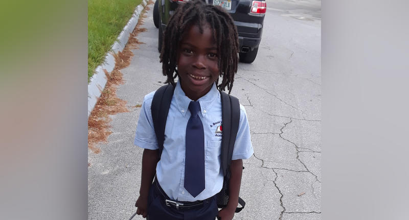 Black African-American Florida primary school boy Clinton Stanley Jr banned from private Christian academy because of dreadlock hair.