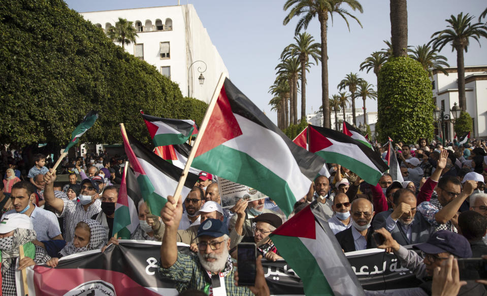 Protesters shout slogans and wave Palestinian flags during a protest in Rabat, Morocco, Sunday, May 16, 2021. (AP Photo/Mosa'ab Elshamy)