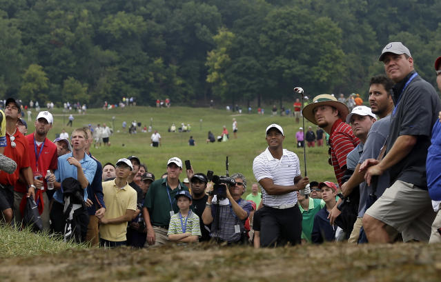 Tiger Woods hits from rough on the sixth hole during the second round of the PGA Championship golf tournament at Valhalla Golf Club on Friday, Aug. 8, 2014, in Louisville, Ky. (AP Photo/Jeff Roberson)