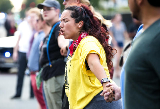 <p>Alissa Ellis chants while blocking an intersection during a rally Monday, Aug. 14, 2017, in Durham, N.C. (Photo: Casey Toth/The Herald-Sun via AP) </p>
