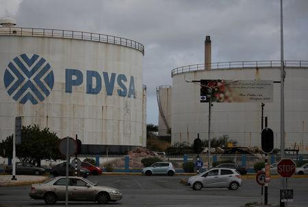 FILE PHOTO: The logo of Venezuelan oil company PDVSA is seen on a tank at Isla refinery in Willemstad on the island of Curacao April 22, 2018. REUTERS/Andres Martinez Casares/File Photo