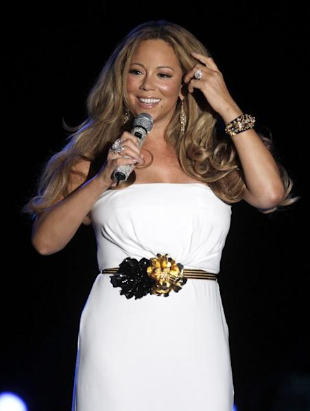 """FILE - This June 2, 2012 file photo shows American singer Mariah Carey performing during a concert in Monaco. Carey will be joining the cast of """"American Idol."""" She told a meeting of the Television Critics Association that she is excited to join as a judge and it all happened quickly. (AP Photo/Lionel Cironneau, file)"""