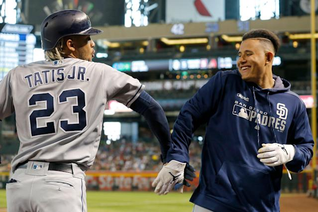San Diego Padres Fernando Tatis Jr. celebrates with Manny Machado after hitting a solo home run against the Arizona Diamondbacks on Sunday, April 14, 2019, in Phoenix. (AP Photo)