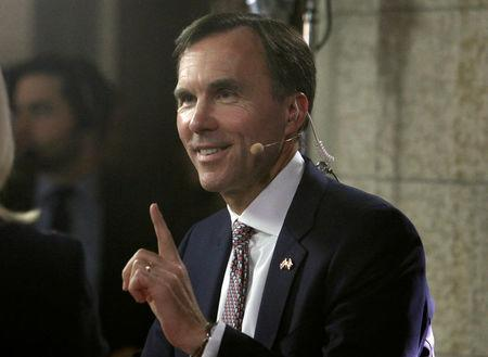 Canada's Finance Minister Bill Morneau speaks to a reporter after delivering the budget on Parliament Hill