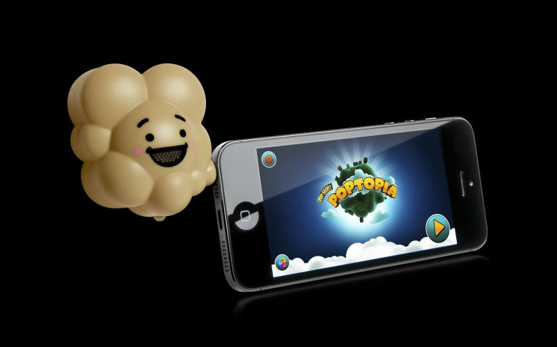 This undated photo provided by Pop Secret shows the company's Pop Dongle, a gadget that is part of an iPhone game created by the popcorn maker. It plugs into your iPhone's earphone jack and at certain points during the game it releases a buttered-popcorn scent. The device is just one of the slightly bizarre gifts available this year for the techie who has everything. (AP Photo/Pop Secret)