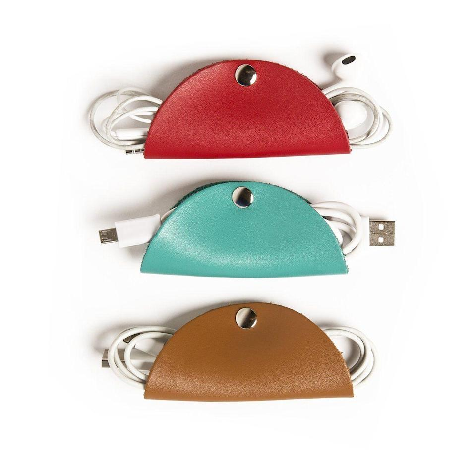 "<p>Save your boss from a mess of jumbled cords in the bottom of her bag with a trio of cord tacos. Made of durable vegan leather, the tacos comes in turquoise, brown, and red and are essential for taking tech on the go.</p> <br> <br> <strong>Brouk & Co</strong> Brouk & Co Cord Taco Trio- Cable Organizer, $14.99, available at <a href=""https://www.amazon.com/Brouk-Cord-Taco-Trio-Accessories/dp/B07CT5SH36/ref=sr_1_3?s=books&ie=UTF8&qid=1544037357&sr=8-3&keywords=cord+taco"" rel=""nofollow noopener"" target=""_blank"" data-ylk=""slk:Amazon"" class=""link rapid-noclick-resp"">Amazon</a>"