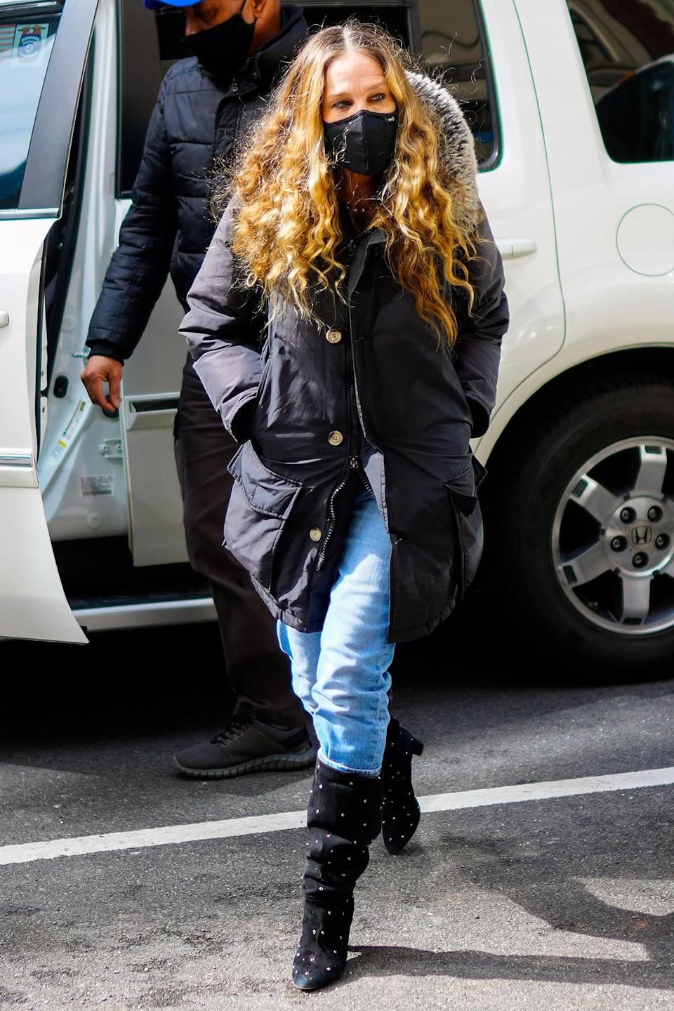 <p>Sarah Jessica Parker makes her way to her SJP store in N.Y.C. on Friday.</p>
