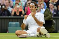 Victory celebration: Federer falls to the floor after defeating Andy Murray in the 2012 final