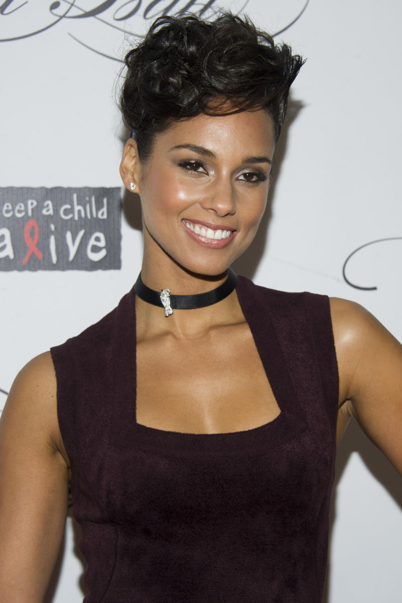"""FILE - This Dec. 6, 2012 file photo shows Alicia Keys at the Keep a Child Alive's ninth annual Black Ball in New York. Keys cut her hair this summer and is now sporting a bob. And she says she """"actually wants to go even shorter"""" in an interview last week. The 31-year-old came on the music scene in 2001 with braids, and has mostly worn her hair long. But she says with her new haircut, she's able to do more with her hair. (Photo by Charles Sykes/Invision/AP)"""