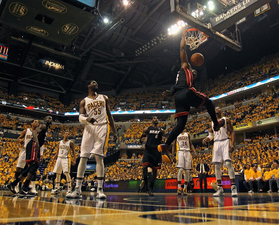 INDIANAPOLIS, IN - MAY 24: Dwyane Wade #3 of the Miami Heat dunks over Roy Hibbert #55 and David West #21 of the Indiana Pacers in Game Six of the Eastern Conference Semifinals in the 2012 NBA Playoffs at Bankers Life Fieldhouse on May 24, 2012 in Indianapolis, Indiana. NOTE TO USER: User expressly acknowledges and agrees that, by downloading and/or using this photograph, User is consenting to the terms and conditions of the Getty Images License Agreement. (Photo by Jonathan Daniel/Getty Images)