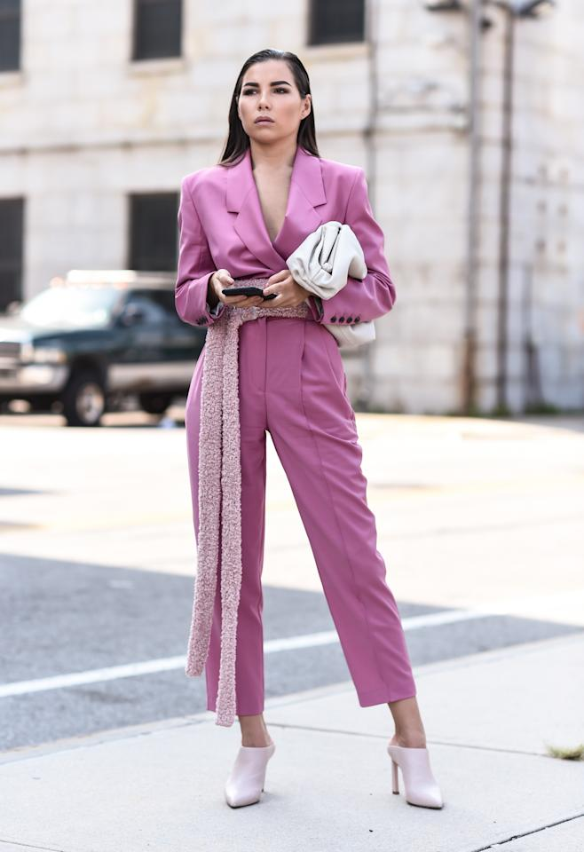 A guest is seen wearing a pink Michael Kors suit outside the Michael Kors show. [Photo: Getty]