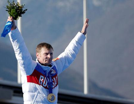 FILE PHOTO: Russia's pilot Zubkov poses with gold medal during ceremony for four-man bobsleigh event at Sochi 2014 Winter Olympics
