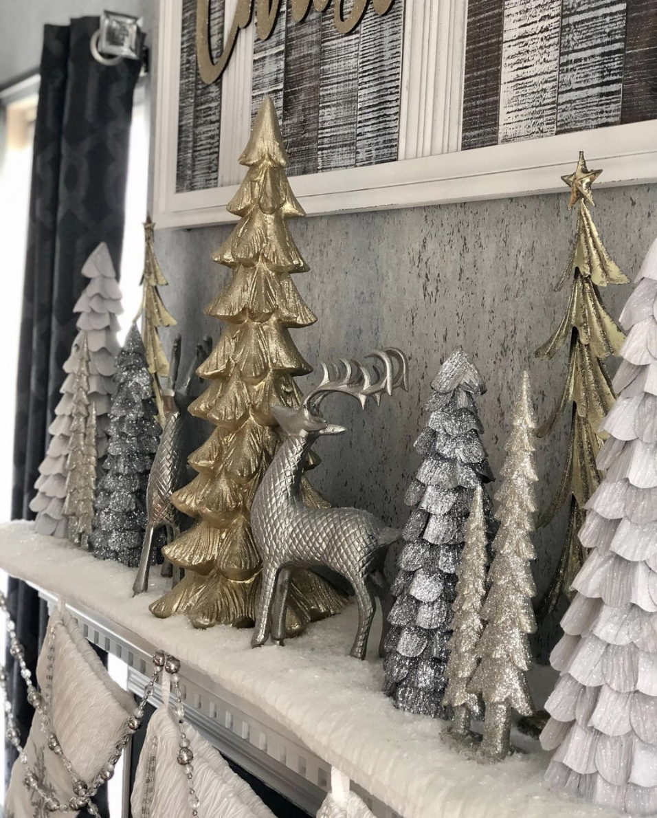 "<p>Whether you go with mercury glass hurricanes, metal reindeer, or gold and silver painted trees (or all of the above!), an array of gilded accents always looks good grouped on the mantel. </p><p><em>See more at <a href=""https://www.instagram.com/p/B6qisKVnFxs/"" rel=""nofollow noopener"" target=""_blank"" data-ylk=""slk:amordecorbyambar"" class=""link rapid-noclick-resp"">amordecorbyambar</a>.</em></p><p><a class=""link rapid-noclick-resp"" href=""https://www.amazon.com/Raz-Champagne-Glittered-Christmas-Trees/dp/B07GNV8ZXG?tag=syn-yahoo-20&ascsubtag=%5Bartid%7C10072.g.34484299%5Bsrc%7Cyahoo-us"" rel=""nofollow noopener"" target=""_blank"" data-ylk=""slk:SHOP METALLIC TREES"">SHOP METALLIC TREES</a></p>"