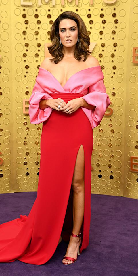 "<p>At the 2019 Emmys, Mandy Moore made a romantic statement in a pink and red <a href=""https://click.linksynergy.com/deeplink?id=93xLBvPhAeE&mid=37385&murl=https%3A%2F%2Fwww.modaoperandi.com%2Fbrandon-maxwell-ss20&u1=IS%2CMandyMoore%2Canesta%2C%2CIMA%2C3482546%2C201909%2CI"" target=""_blank"">Brandon Maxwell</a> gown and Forevermark jewelry.</p>"