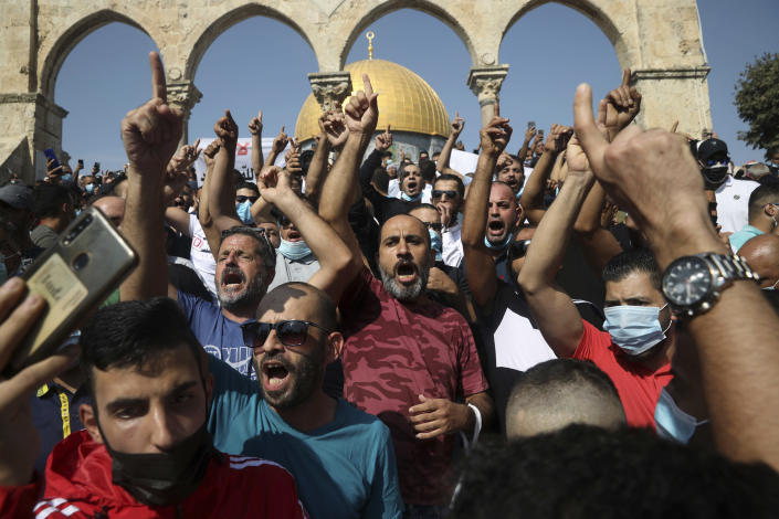 Palestinians chant slogans against French President Emmanuel Macron and the publication of caricatures of the Muslim Prophet Muhammad at the Dome of the Rock Mosque after Friday prayers in the Old City of Jerusalem, on Oct. 30, 2020. (AP Photo/Mahmoud Illean)