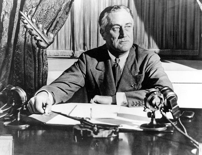 """President Franklin D. Roosevelt delivers his first radio """"fireside chat"""" in Washington In this March 1933 photo. The New Deal was a try-anything moment during the Great Depression that remade the role of the federal government in American life."""