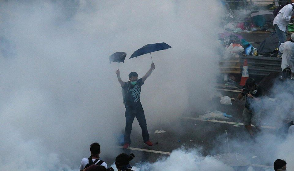 Police fire tear gas at protesters in Admiralty at the outset of Occupy Central in 2014. Photo: K. Y. Cheng