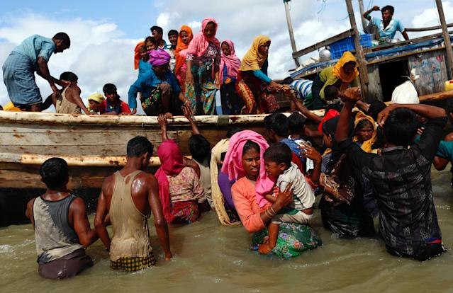 Rohingya refugees get off a boat after crossing the Bangladesh-Myanmar border through the Bay of Bengal on Sept. 11. (Photo: Danish Siddiqui/Reuters)