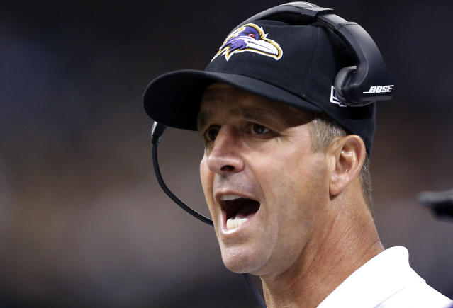 Baltimore Ravens coach John Harbaugh calls out from the sideline in the first half of an NFL preseason football game against the New Orleans Saints in New Orleans, Thursday, Aug. 28, 2014. (AP Photo/Rogelio Solis)