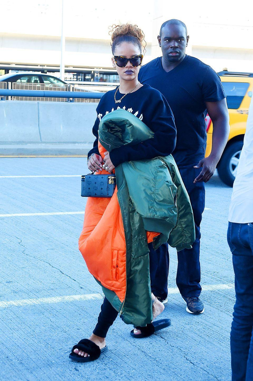 <p>Although classic Adidas slides made a huge comeback, more dressed-up versions, including ones with furry or embellished details on the strap, also became popular. Rihanna got in on the luxe-but-casual trend while out in New York City. </p>