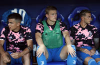 Juventus' Matthijs de Ligt, center, looks out from the bench prior the Serie A soccer match between Parma and Juventus at the Tardini stadium, in Parma, Italy, Saturday, Aug. 24, 2019. (AP Photo/Antonio Calanni)