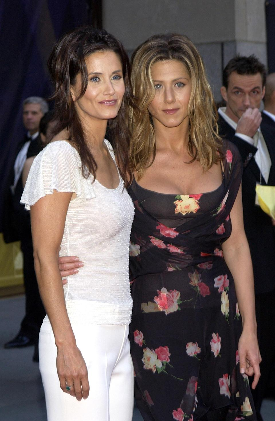 <p>Jennifer, sporting a floral dress and tousled waves, attended the NBC party in 2002 alongside the rest of the 'Friends' cast – including Courteney, in another all-white look. <em>[Photo: Getty]</em> </p>