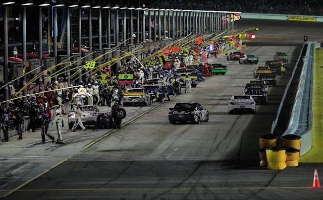 HOMESTEAD, FL - NOVEMBER 20: Cars drive off of pit road during the NASCAR Sprint Cup Series Ford 400 at Homestead-Miami Speedway on November 20, 2011 in Homestead, Florida. (Photo by Chris Trotman/Getty Images for NASCAR)