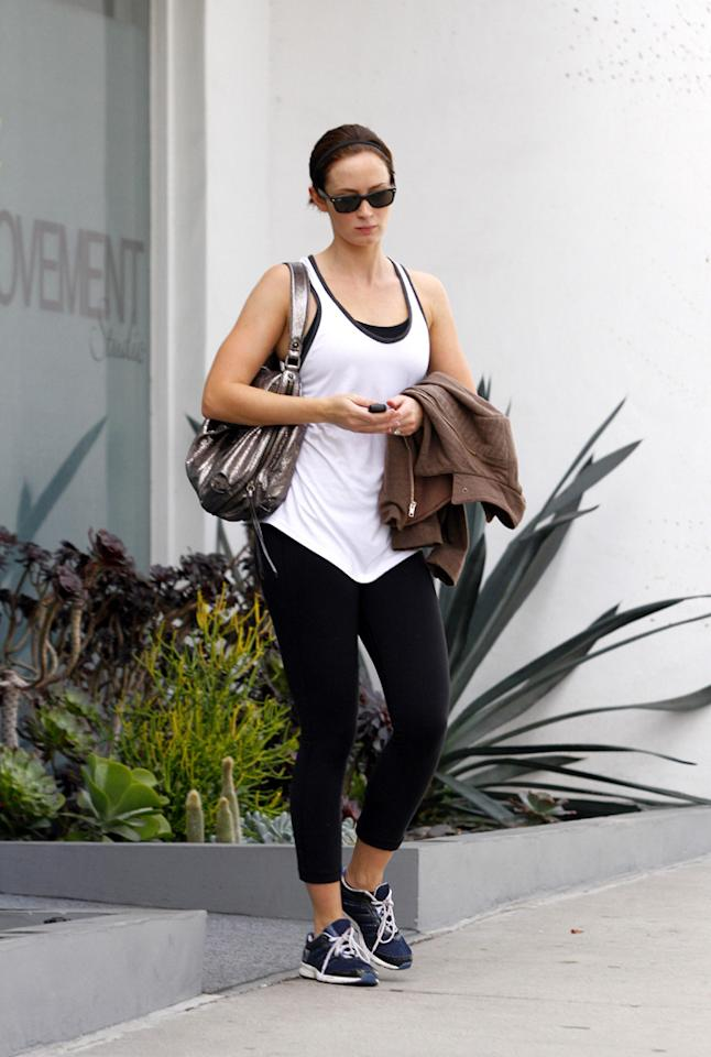 """John Krasinski's better half, Emily Blunt, was also photographed on Wednesday post workout. But unlike Nicole Richie, the """"Devil Wears Prada"""" star wasn't willing to smile while all sweaty. <a href=""""http://www.infdaily.com"""" target=""""new"""">INFDaily.com</a> - September 28, 2011"""