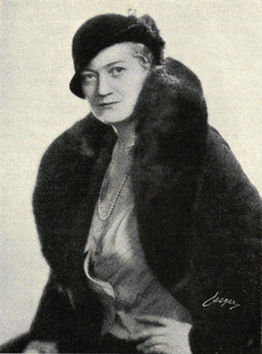 Black and white picture of a woman in a fur coat.