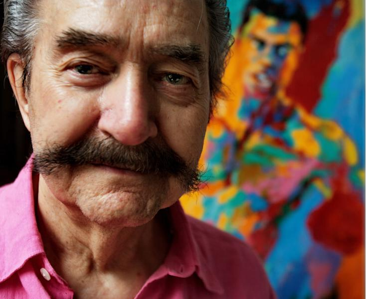 FILE - In this Aug. 31, 2007 file photo, artist LeRoy Neiman poses in his studio in New York. Neiman, who is best known for his colorful and energetic paintings of sporting events, died Wednesday, June 20, 2012 in New York. He was 91. (AP Photo/Bebeto Matthews, File)