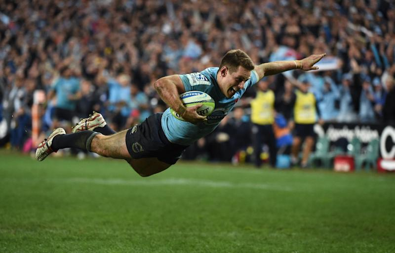 New South Wales Waratah's flyhalf Bernard Foley dives over to score a try against the ACT Brumbies in their Super 15 semi-final rugby match in Sydney on July 26, 2014