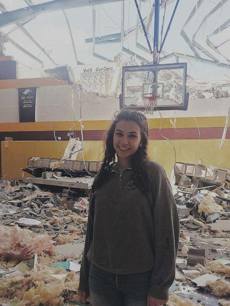 PHOTO: Senior class president, Allison Sigler, poses in front of, what once was, the senior hallway after the tornado in Chattanooga, Tenn. (Courtesy of Allison Sigler)
