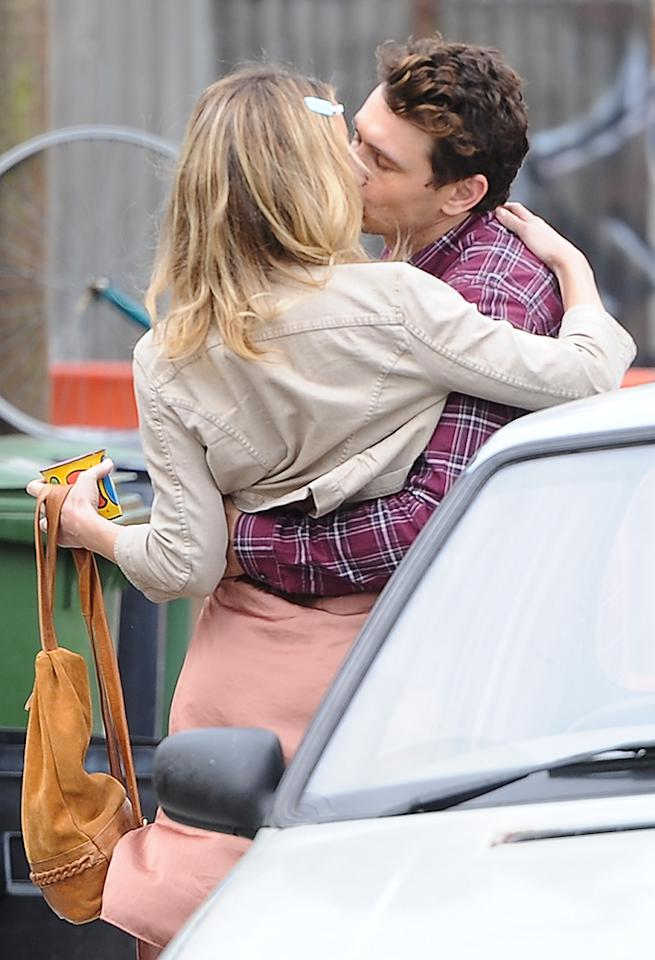 Kate Hudson and James Franco on location in East london, filming scenes for the new movie 'Good People'. James Franco is seen kissing Kate Hudson. The scene is filmed in a terrace house that the movie company had taken 3 days to paint to look old.