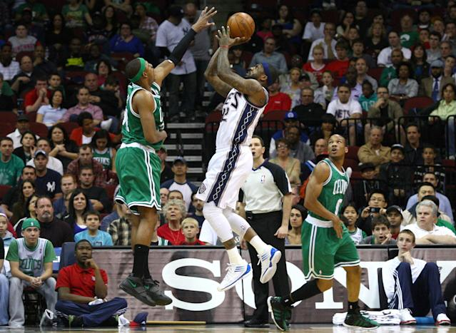 NEWARK, NJ - APRIL 14: DeShawn Stevenson #92 of the New Jersey Nets attempts a shot in the first half against Paul Pierce #34 and Avery Bradley #0 of the Boston Celtics at Prudential Center on April 14, 2012 in Newark, New Jersey. NOTE TO USER: User expressly acknowledges and agrees that, by downloading and or using this photograph, User is consenting to the terms and conditions of the Getty Images License Agreement. (Photo by Chris Chambers/Getty Images)