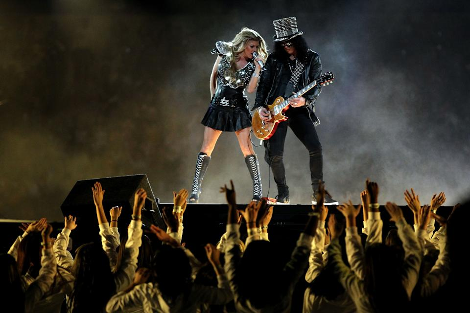 Fergie of the Black Eyed Peas performs with Slash during the Bridgestone Super Bowl XLV Halftime Show at Cowboys Stadium on February 6, 2011 in Arlington, Texas. (Photo by Al Bello/Getty Images)