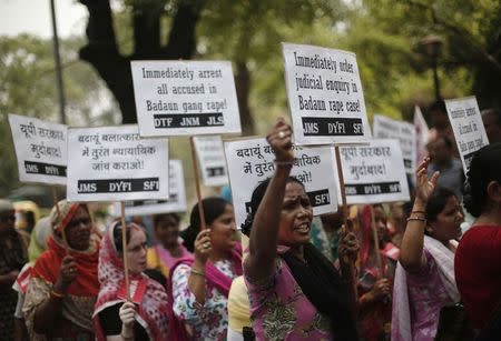 Demonstrators from AIDWA hold placards and shout slogans during protest against recent killings of two teenage girls, in New Delhi