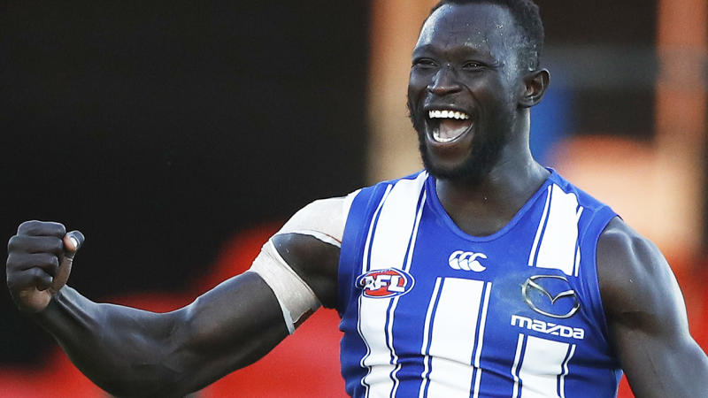 Majak Daw is pictured celebrating after scoring a goal in his AFL comeback for North Melbourne.