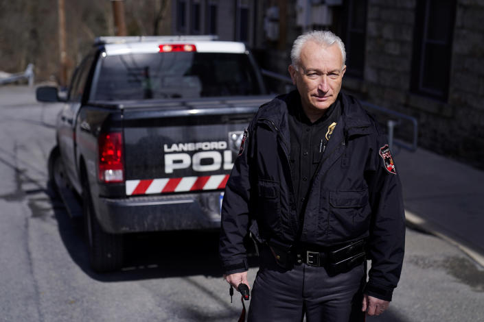 """Lansford Police Chief Jack Soberick stands next to his truck, Friday, March 12, 2021, in Lansford, Pa. On May 26, 2020, police found 9-year-old Ava Lerario; her mother, Ashley Belson, and Ava's father, Marc Lerario, fatally shot inside their home. Soberick was the first to respond to the scene. """"I don't believe this would have happened this way if not for the pandemic pushing him beyond the brink,"""" Soberick said of Marc Lerario. """"I wish Marc would have gotten treatment for the bipolar disorder."""" (AP Photo/Matt Slocum)"""