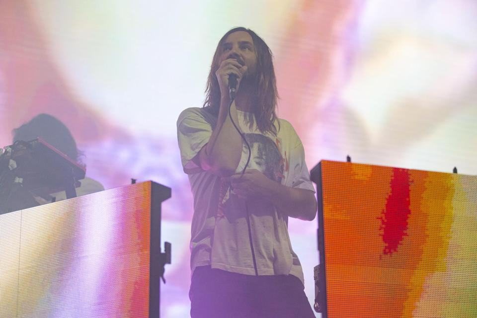 Photo of frontman, Kevin Parker of Tame Impala performing live
