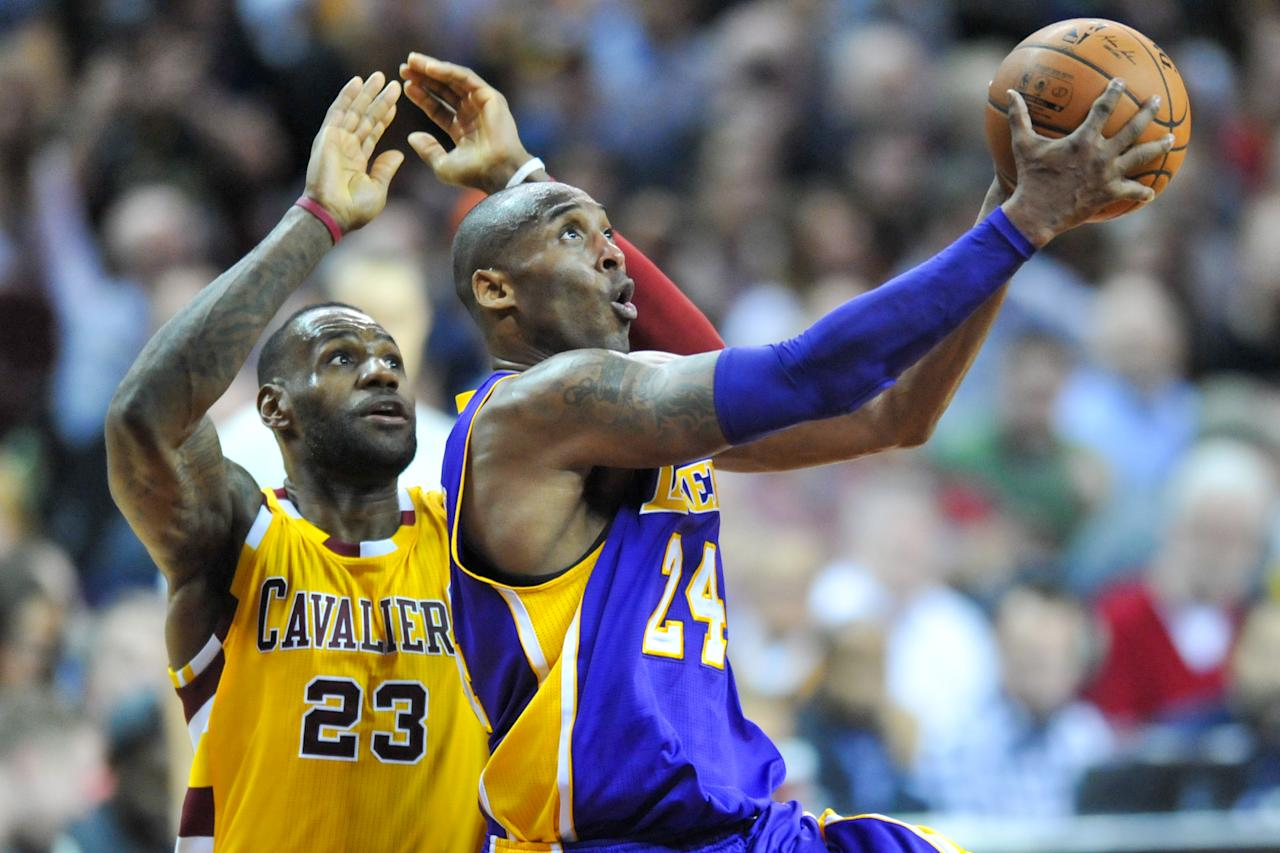 CLEVELAND, OH - FEBRUARY 10, 2016: Kobe Bryant #24 of the Los Angeles Lakers drives to the basket against LeBron James #23 of the Cleveland Cavaliers in the second half of a game on February 10, 2016 at Quicken Loans Arena in Cleveland, Ohio. Cleveland won 120-111. (Photo by: 2016 Nick Cammett/Diamond Images via Getty Images)