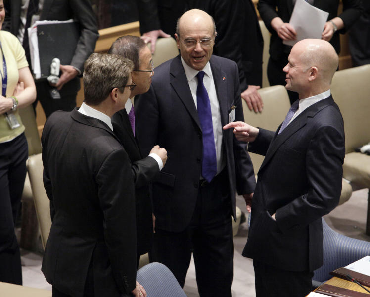 From left to right, German Foreign Minister Guido Westerwelle, U.N. Secretary-General Ban Ki-moon, French Foreign Minister Alain Juppe, and British Foreign Minister William Hague talk before the Security Council meeting at United Nations headquarters, Monday, March 12, 2012. The bloody conflict in Syria is likely to dominate public and private talks Monday as key ministers meet at the United Nations on the Israeli-Palestinian conflict and challenges from the Arab Spring. (AP Photo/Richard Drew)