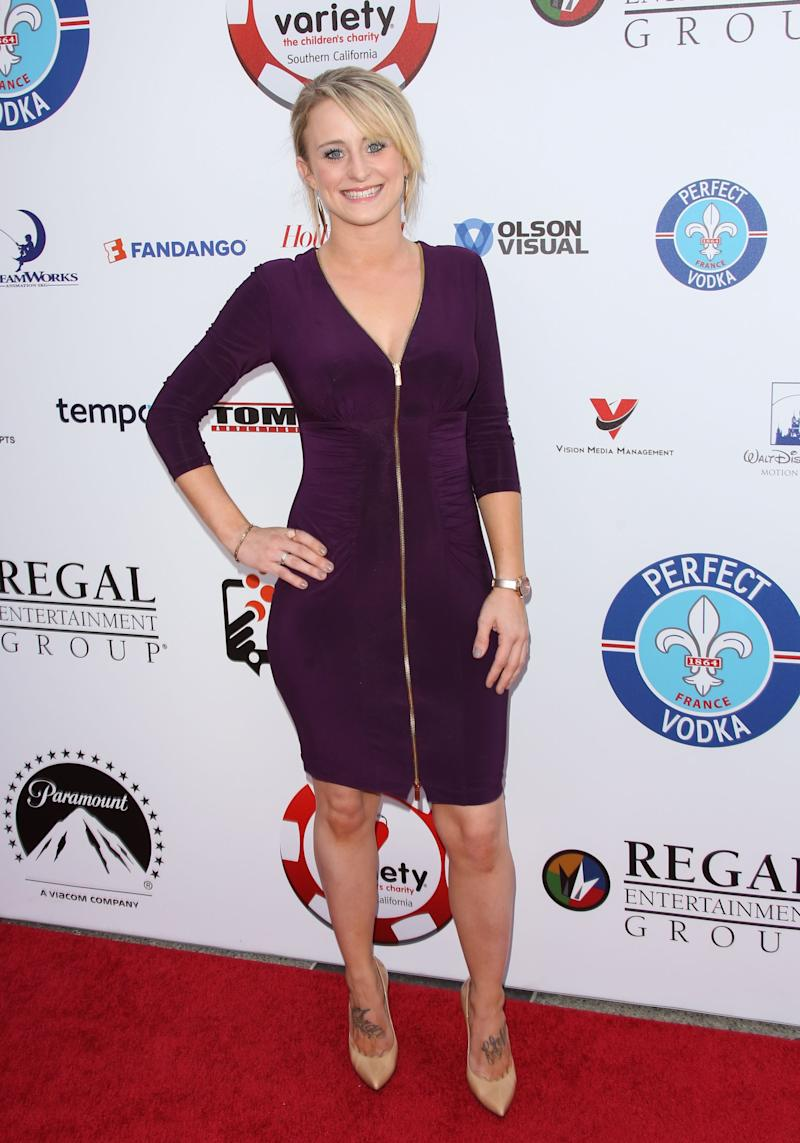 Leah Messer looking gorgeous in a knee-length purple dress with front zip