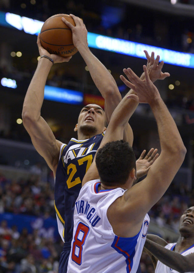 Utah Jazz center Rudy Gobert, left, of France, shoots as Los Angeles Clippers forward Hedo Turkoglu, of Turkey, defends during the first half of an NBA basketball game on Saturday, Feb. 1, 2014, in Los Angeles. (AP Photo/Mark J. Terrill)