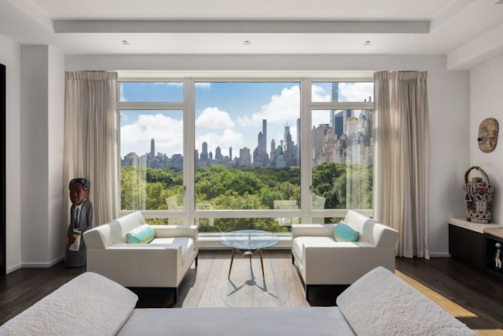 Main living area in the Jeffrey Beers-renovated apartment at 15 Central Park West, with gorgeous views of NYC visible just beyond the large windows.