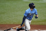Tampa Bay Rays' Austin Meadows watches his double off New York Yankees starting pitcher Jameson Taillon during the fifth inning of a baseball game Thursday, May 13, 2021, in St. Petersburg, Fla. (AP Photo/Chris O'Meara)