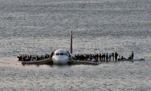 PHOTO: In this Thursday Jan. 15, 2009 file photo, airline passengers wait to be rescued on the wings of a US Airways Airbus 320 jetliner that safely ditched in the frigid waters of the Hudson River in New York. (Steven Day/AP Photo)