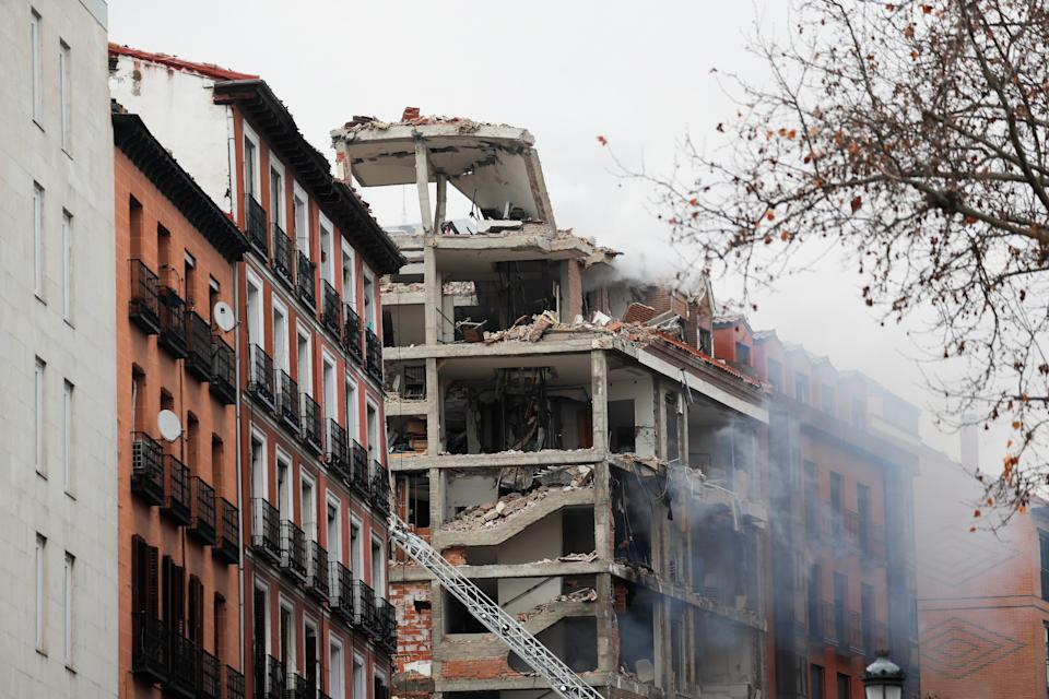 <p>Smoke rises from a damaged building after an explosion in Madrid downtown</p> (Reuters)