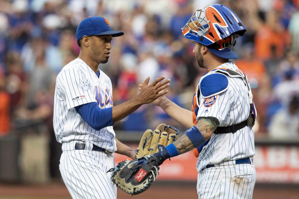 New York Mets relief pitcher Edwin Diaz, left, and catcher Tomas Nido celebrate their win over the Miami Marlins at the end of the ninth inning of a baseball game, Monday, Aug. 5, 2019, in New York. (AP Photo/Mary Altaffer)