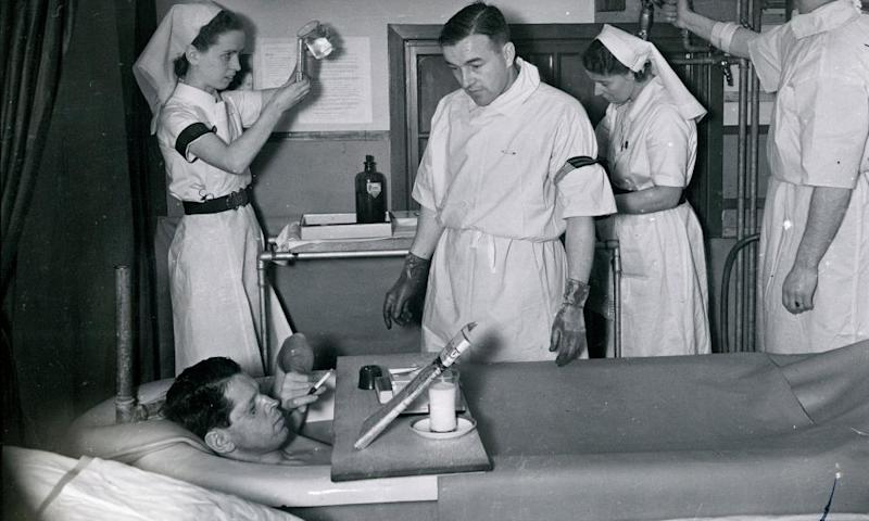 A patient enjoys a cigarette as he takes a saline bath at the Queen Victoria hospital in East Grinstead, West Sussex